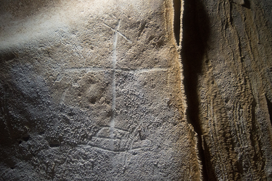 This is one of numerous crosses found in the caves. Credit: Jago Cooper and Alice Samson