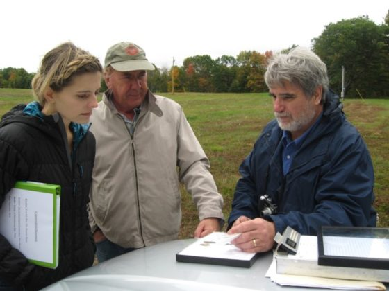 Looking at site maps with Conservancy President Mark Michel and Maine State Archaeologist Art Spiess at the Dresden Preserve in Maine. Photo The Archaeological Conservancy.