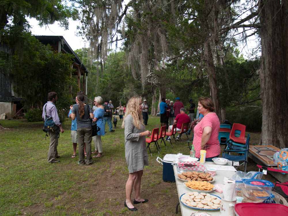 "A refreshment table beneath the 200 year old cedars was stocked with donated sweets from our supporters. The open house began with a ""blessing of the new roof"" by a descendant of the Ross family. (photo Jerry Bangham)"