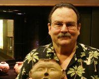 Dr. Jeffrey M. Mitchem holding an Arkansas headpot. Photo courtesy Arkansas Archeological Survey.