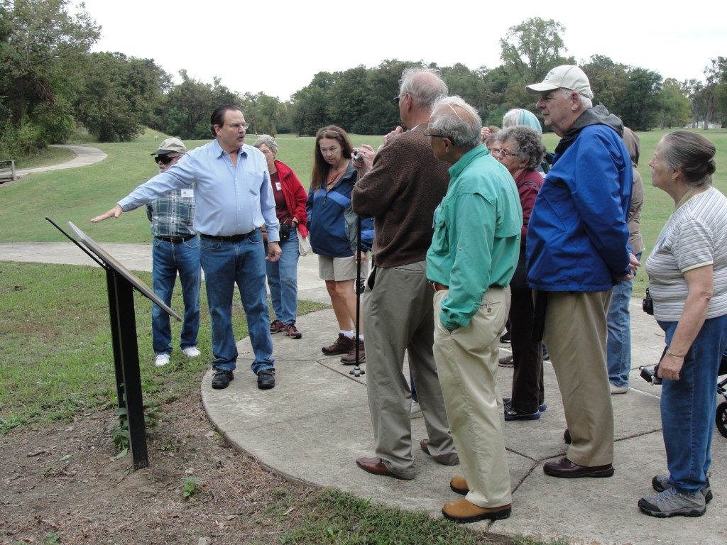 ". Jeff Mitchem showing participants in TAC's ""Peoples of the Lower Mississippi Valley"" tour around the Parkin site, October, 2014. Photo courtesy Parkin Archeological State Park."