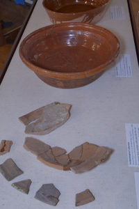These ceramic sherds and vessels are on display in the archaeology laboratory at Plimoth Plantation. Credit: Bruce T. Martin.