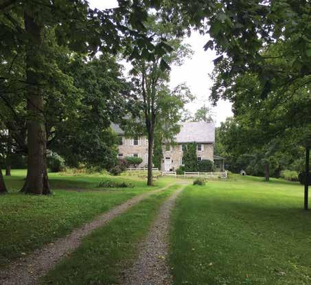 The Allison-Ebbert house, built circa 1756, is seen in the distance.