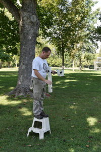 Jarrod Burks prepares a magnetometer for data collection at Serpent Mound. Credit: Roy Willman.