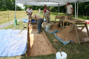 Volunteers and archaeologists from Ohio Valley Archaeology, Inc. excavate a trench across a portion of the lost coil feature detected in the magnetic survey in 2011. Credit: Jarrod Burks.