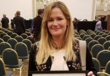 Jessica Crawford, TAC Regional Director, receives special recognition from SEAC.