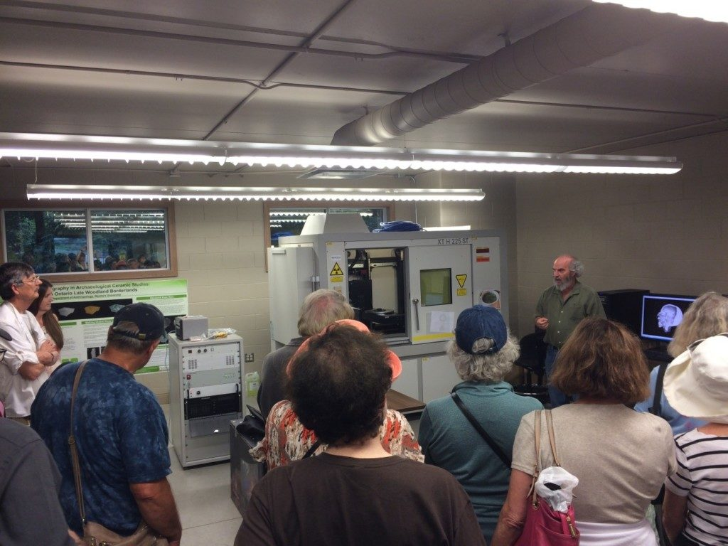 The group learns about the archaeological uses of a Micro-CT Scanner at the Sustainable Archaeology Facility in London, Ontario.