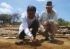 Germán Ramírez Jiménez (left) excavates a brick inside a structure as Lane Fargher looks on. Credit: Lizzie Wade.