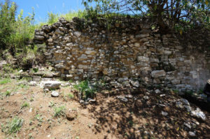 This partially collapsed plaza retaining wall is near an excavated household group. Credit: Courtesy of Tlaxcallan Archaeological Project