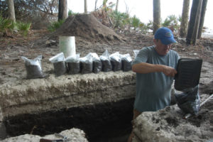 Sassaman collects bulk samples from a column of archaeological midden and overlying storm-surge sands at Cat Island in May 2009. Credit: Laboratory of Southeastern Archaeology, University of Florida