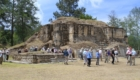 The group visiting a temple structure at Iximche