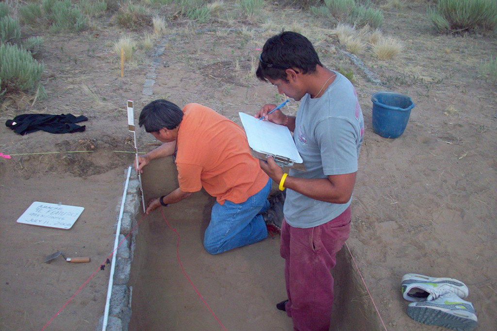 A former Amache internee (kneeling) works in an excavation unit while a University of Denver student records data. Credit: Denver University's Amache Project