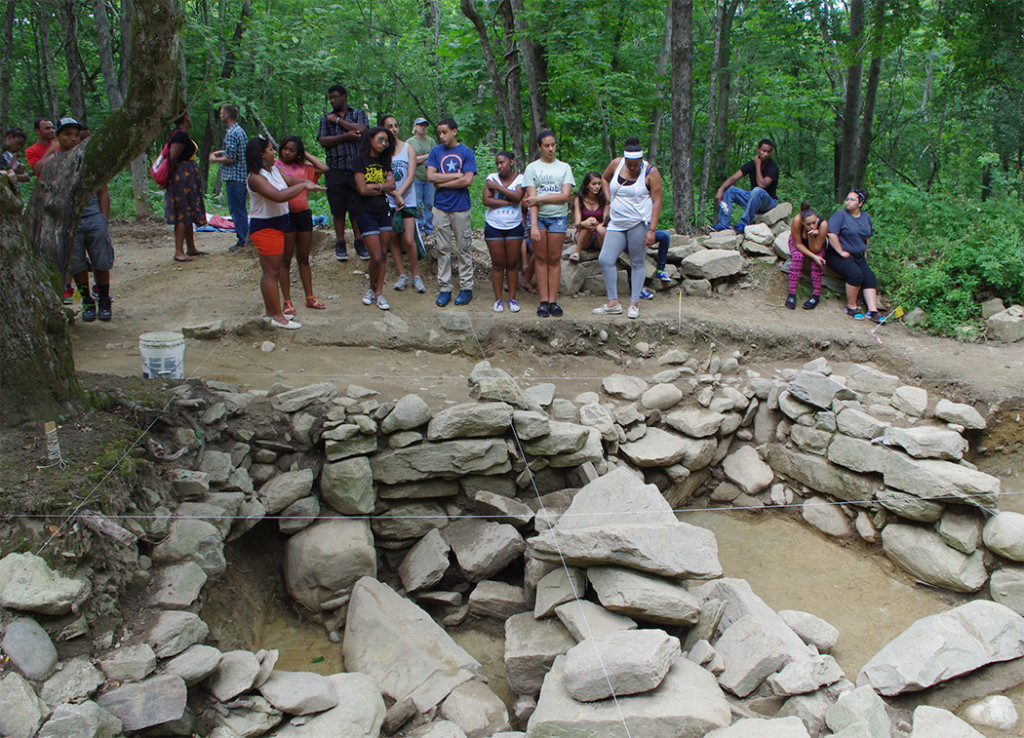 Nipmuc high school students visit a site that is part of the Hassanamesit Woods project. Credit: Heather Law Pezzarossi
