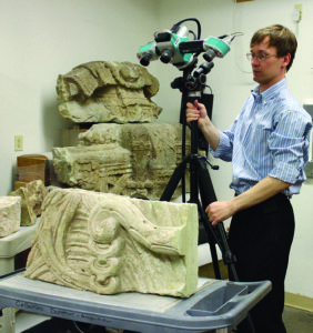 Alexandre Tokovinine sets up the 3D scanner to capture a section of the plumage from the first seated figure on the Hieroglyphic Stairway. This piece was brought to the Peabody Museum's collection along with several others in the nineteenth century shortly after its discovery. Credit: Barbara Fash