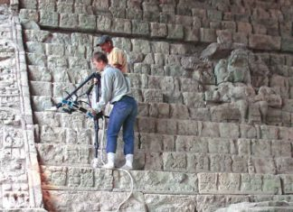 COVER: Researchers carefully position a 3-D scanner on the fragile steps of Copán's Hieroglyphic Stairway. The scans are used to reproduce the stairway. Credit: Barbara Fash