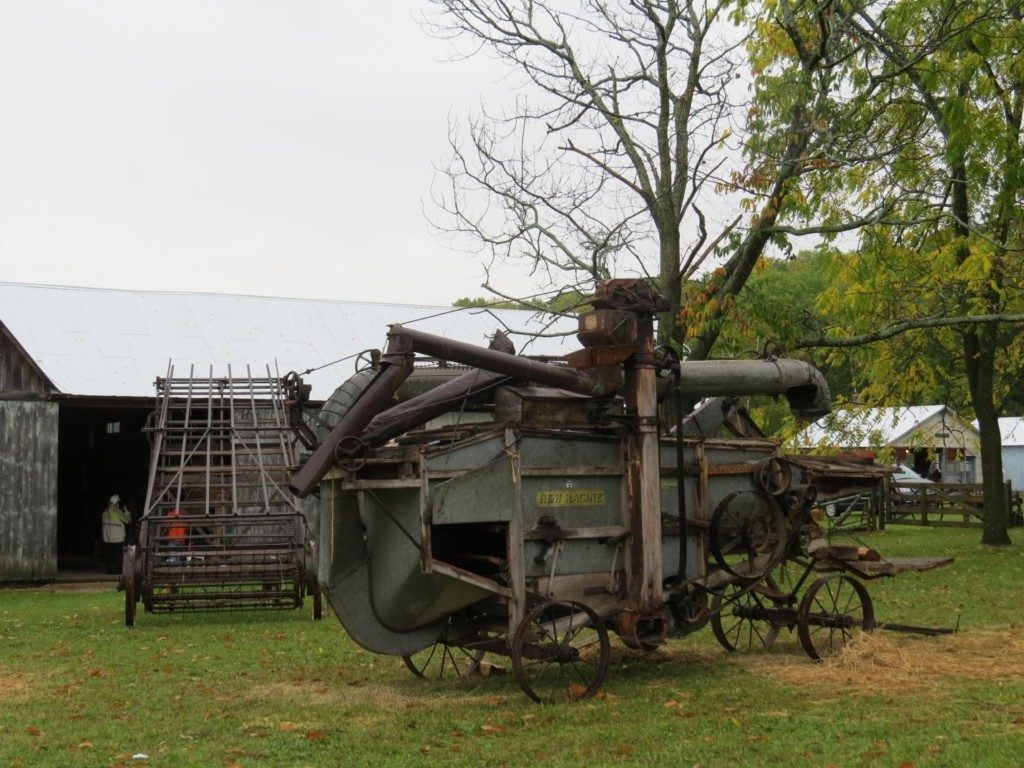 Antique thresher (foreground) and hay bailer (background).