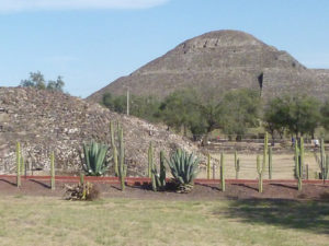 Teotihuacan's Pyramid of the Moon towers over a small temple-pyramid in the foreground of this photograph. Archaeologists haven't found much variation in house sizes between the rich and the poor here. Credit Michael E. Smith