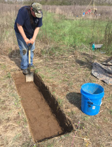 Carol Butler of the Sac and Fox nation digs a trench. Sixteen tribes have a connection to Hiwassee Island. Credit: TVA