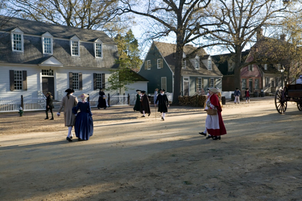 """Costumed Interpreters walk up and down Colonial Williamsburg's Duke of Gloucester Street amid eighty-eight original eighteenth-century homes and shops and more than 400 reconstructed buildings. In 1934 President Franklin Delano Roosevelt called DOG Street, as it is known locally, """"the most historic avenue in all America."""" Credit: Colonial Williamsburg Foundation."""