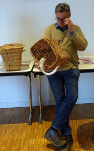At the November 2017 Wetlands and Archaeology conference at Mont-Beuvray—Glux-en-Glenne France, Ed Carriere and Dale Croes showed their Biderbost basket replicas during their presentation. Vincient Guichard, the director of the European Archaeological Center that hosted the conference, examines Carriere's Archaeology Basket; Croes' Biderbost pack basket replica is beside him. Credit: Dale Croes
