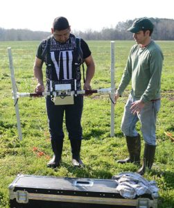 – Members of federal-recognized Indian tribes participated in the fieldwork on Hiwassee Island. Here Gano Perez of the Muscogee (Creek) Nation and archaeologist Shawn Patch of New South Associates collect magnetometer data. Credit : TVA