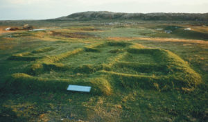 The remains of Hall F, the largest building at L'Anse aux Meadow, are seen here. Leif Eriksson, who led the Vinland expedition, is thought to have lived here. Photo by Rob Ferguson/Parks Canada